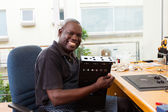 African man assembly electronic equipment — Stock Photo