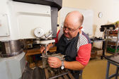 Senior artisan working in workshop — Stock Photo