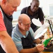 Group of senior electrical technicians — Stock Photo