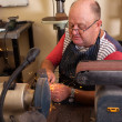 Senior man using grinding machine — Stock Photo