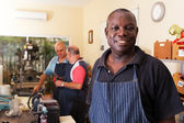 Senior african metal worker in workshop — Stock Photo