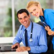 Stock Photo: Happy medical nurse and doctor in office