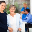 Daughter and senior mother in doctors office — Stockfoto