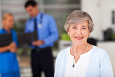 Ederly woman in doctors office — Stock Photo