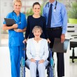 Health workers and senior patient — Foto de Stock