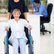 Young woman and senior mother in doctor&#039;s office - Stock Photo