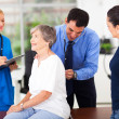 Medical doctor examining senior patient — Stock Photo #24842007
