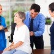 Medical doctor examining senior patient — Stock Photo