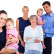 Young woman holding her baby with extended family on background — Stock Photo