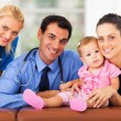 Stock Photo: Woman and baby girl with health workers