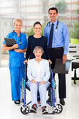 Health workers and senior patient — Stock Photo