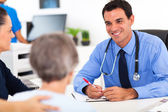 Medical doctor consulting senior patient — Stock Photo