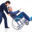 Royalty-Free Stock Photo: Mature couple having fun with wheelchair
