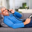 Middle aged man talking on the telephone — Stock Photo