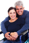 Loving supportive husband hugging disabled wife — Stock Photo