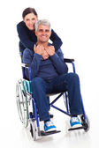 Supportive middle aged wife and disabled husband — Stock Photo