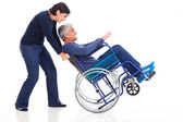 Mature couple having fun with wheelchair — Stock Photo