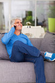 Middle aged man talking on cell phone — Stock Photo