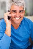 Mature man talking on mobile phone — Stock Photo