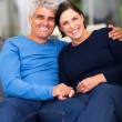 Loving mature couple relaxing at home — Stock Photo #25040207