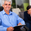 Middle aged male psychologist in office — Stock Photo