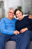 Loving mature couple relaxing at home — Stock Photo