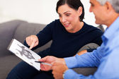 Mature female patient looking at Rorschach inkblot with psycholo — Stock Photo