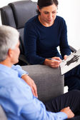 Senior man doing Rorschach inkblot test with therapist — Stock Photo