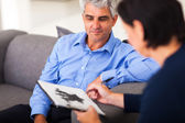 Middle aged man in session with therapist — Stock Photo