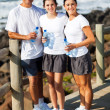 Family at the beach after exercise — Stock Photo