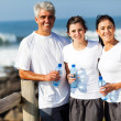 Stock Photo: Family relaxing after exercise at the beach