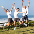 Stock Photo: Active family jumping