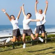 Foto Stock: Active family jumping