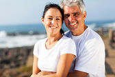 Middle aged couple hugging at the beach — Stock Photo