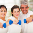 Portrait of fit family having fun with dumbbells — Stock Photo