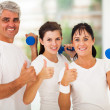 Healthy family giving thumbs up - Foto Stock