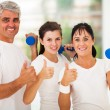Healthy family giving thumbs up — Stock Photo