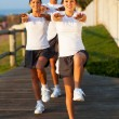 Teenage daugther exercising her parents — Stock Photo #25257433