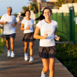 Modern family jogging — Stock Photo