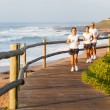 Family running by the beach — Stock Photo #25258243