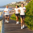 Family running by the beach — Stock Photo #25258489