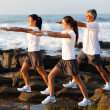 Family workout at the beach - Stock Photo