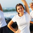 Teenage girl and her parents working out at the beach — Stock Photo #25259001