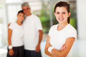 Sporty teen girl and parents — Stock Photo