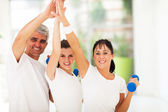 Family doing high five after exercising — Stock Photo