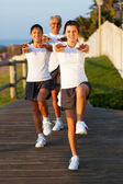 Teenage daugther exercising her parents — Stockfoto