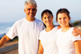 Healthy family by the beach in the morning — Stock Photo