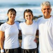 Fit family at the beach after exercising — Stock Photo