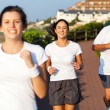 Foto Stock: Happy active family jogging