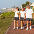 Active healthy family walking by the beach - Stock Photo